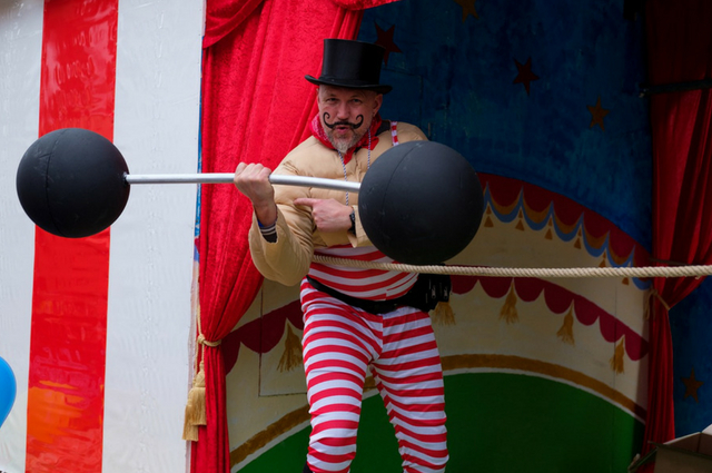 A man weightlifting at the circus