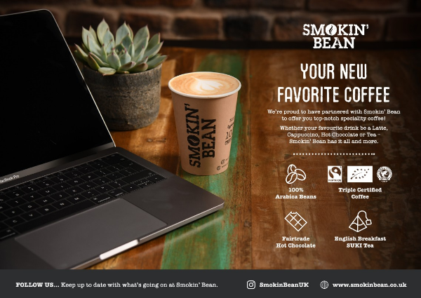 Image of a advert announcing partnership with brand Smokin Bean. Showing a laptop and a cup of coffee.