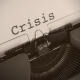 An image of an old vintage typewriter with written word crisis