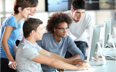 Apprentices around computer