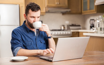 Man working at home on a computer