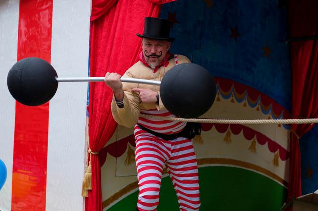 A man weightlifting at the circus