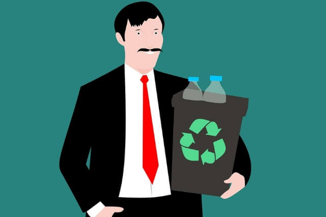 Picture of an office worker holding a recycling bin with plastic bottles