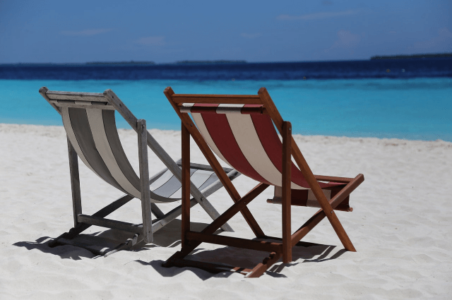 Picture of empty deckchairs on a bright sunny beach
