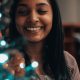 Picture of a female offie working sitting near a Christmas tree