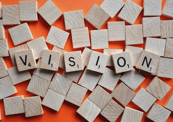 Image of wooden tiles spelling the word vision