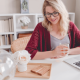 Woman working happily from her laptop at home