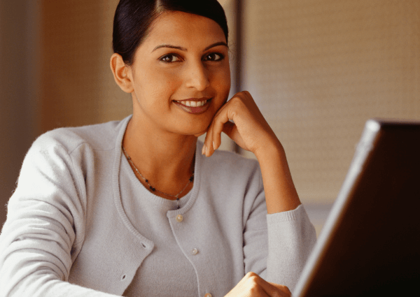 Image of a woman working on her laptop